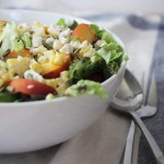 Peach and corn salad with sweet onion vinaigrette